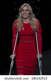 NEW YORK, NY - FEBRUARY 06, 2014: Lindsey Vonn on cratches wearing Cynthia Rowley dress walks runway for The Heart Truth's Red Dress Collection at Mercedes-Benz Fall/Winter 2014 Fashion Week