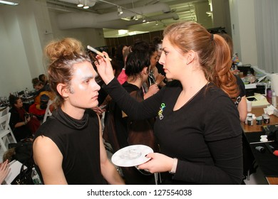 NEW YORK, NY- FEBRUARY 07: Makeup artist applying make-up to model backstage at the Elliott Evan Collection?�� for F/W 2013 during Mercedes-Benz Fashion Week on February 07, 2013 in NYC.