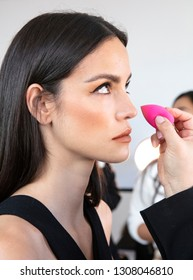 New York, NY - February 08, 2019: A model prepares backstage for the Cushnie Fall Winter 2019 fashion show during New York Fashion Week