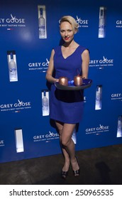 NEW YORK, NY - FEBRUARY 08, 2015: Waitress holds tray with Grey Goose cups at the GREY GOOSE and Stadiumred New York VIP Grammy Awards Party at Liberty Theater