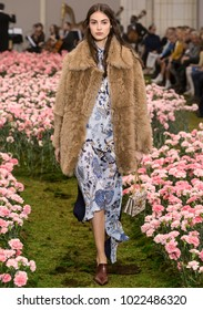 NEW YORK, NY - February 09, 2018: Camille Hurel walks the runway at the Tory Burch Fall Winter 2018 fashion show during New York Fashion Week