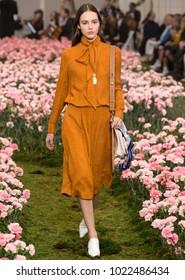 NEW YORK, NY - February 09, 2018: Emm Arruda walks the runway at the Tory Burch Fall Winter 2018 fashion show during New York Fashion Week