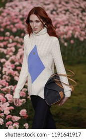NEW YORK, NY - FEBRUARY 09: A model walks the runway during the Tory Burch Fall Winter 2018 Fashion Show during New York Fashion Week at Bridge Market on February 9, 2018 in New York City.