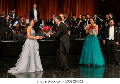 New York, NY - February 1, 2019: Daniel Serafin present flowers to opera singers final bow during New York 64th Viennese Opera Ball at Cipriani 42nd street