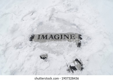 New York, NY - February 1, 2021: View of Strawberry Field Imagine mosaic in memory of John Lennon covered with snow as major storm cover New York City with more than a foot expected on the ground