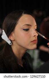 NEW YORK, NY - FEBRUARY 11: Model gets ready backstage at the Zero + Maria Cornejo Fall 2013 Fashion Show on February 11, 2013 in New York City.