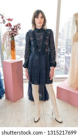 New York, NY - February 11, 2019: Model shows off dress by J. Mendel during Fall/Winter fashion week at The Standard East Village Penthouse