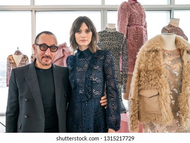 New York, NY - February 11, 2019: Designer J. Mendel and model pose at J. Mendel presentation during Fall/Winter fashion week at The Standard East Village Penthouse