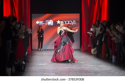 NEW YORK, NY - FEBRUARY 11, 2016: Monica wearing dress by Ieena for Mac Duggal sings on runway for the Heart Truth Red Dress Collection 2016 fashion show at Moynihan Station