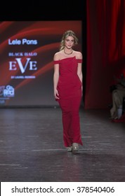 NEW YORK, NY - FEBRUARY 11, 2016: Lele Pons wearing dress by Black Halo Eve walks runway for the Heart Truth Red Dress Collection 2016 fashion show at Moynihan Station