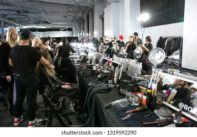 New York, NY - February 13, 2019: A model prepares backstage for the Boss Fall Winter 2019 fashion show during New York Fashion Week