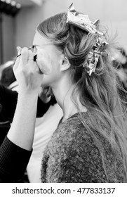 New York, NY - February 13, 2016: A model prepares backstage for the Monique Lhuillier Fall 2016 fashion show during New York Fashion Week