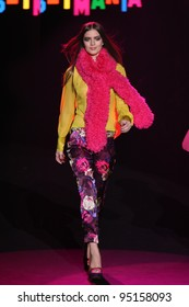 NEW YORK, NY - FEBRUARY 13: A model walks the runway at the Betsey Johnson Fall 2012 fashion show during Mercedes-Benz Fashion Week at Lincoln Center on February 13, 2012 in New York City.