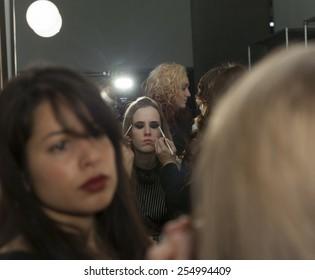 New York, NY - February 14, 2015: Model prepares backstage for PRMITV WORLD presentation at Fall 2015 Fashion Week at Pier 59 Studio