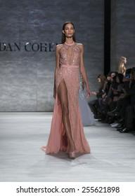 New York, NY - February 14, 2015: Model walks runway for Idan Cohen show at Fall 2015 Fashion Week at Lincoln Center