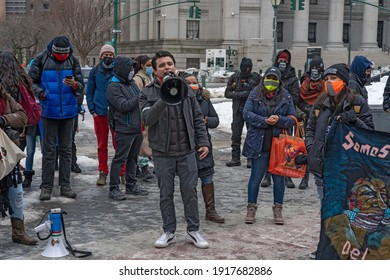 """NEW YORK, NY - FEBRUARY 15: Demonstrators call to """"Free Them All"""" during an Abolish ICE (Immigration and Customs Enforcement) protest for Javier Maradiaga on February 15, 2021 in New York City."""