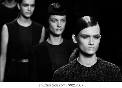 NEW YORK, NY - FEBRUARY 16: Models walk the runway at the Calvin Klein Fall 2012 fashion show during Mercedes-Benz Fashion Week on February 16, 2012 in New York City, USA
