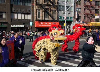 NEW YORK, NY - FEBRUARY 17 : Parade on streets in Chinatown during the Annual Lunar New year on February 17, 2013 in New York City. This year celebrates the Year of the Snake.