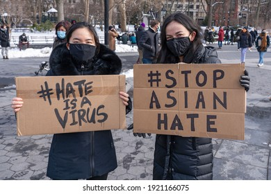 NEW YORK, NY - FEBRUARY 20: Protestors hold signs at the End The Violence Towards Asians rally in Washington Square Park on February 20, 2021 in New York City.