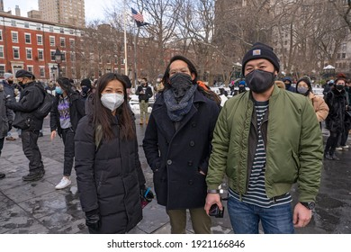 NEW YORK, NY - FEBRUARY 20: Protestors seen at the End The Violence Towards Asians rally in Washington Square Park on February 20, 2021 in New York City.