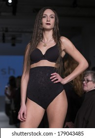 NEW YORK, NY - FEBRUARY 24, 2014: Model walks runway for Lingerie fashion night IN show by Body Hush during CurveExpo at Tribeca Skyline Studios