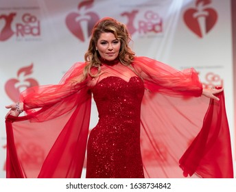 New York, NY - February 5, 2020: Shania Twain wearing dress by Tony Iniguez walks runway for The American Heart Association's Go Red For Women Red Dress Collection 2020 at Hammerstein Ballroom