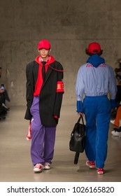 New York, NY - February 7, 2018: Model walks runway for Peacebird x Coca-Cola collection at China Day at Autumn/Winter 2018 New York Fashion Week at Skylight Modern