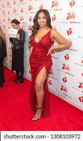 New York, NY - February 7, 2019: Jordyn Woods wearing dress by The Population attends The American Heart Association's Go Red for Women Red Dress Collection 2019 at Hammerstein Ballroom
