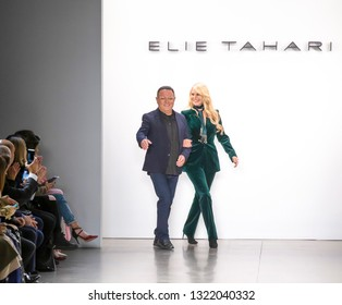 New York, NY - February 7, 2019: Elie Tahari and Christie Brinkley walk the runway at the Elie Tahari Fall/Winter 2019 fashion show during New York Fashion Week at Spring Studios