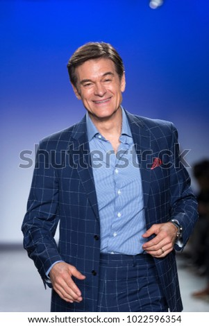 New York, NY - February 7, 2018: Dr. Oz Mehmet Oz wearing jacket by Bruno Magli walks runway for Blue Jacket Fashion Show to benefit Prostate Cancer Foundation at Pier 59