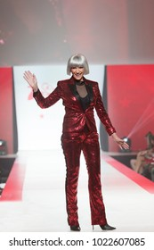 New York, NY - February 8, 2018: Maye Musk wearing gown by Redemption walks runway for Red Dress 2018 Collection Fashion Show at Hammerstein Ballroom