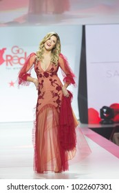 New York, NY - February 8, 2018: Grace Helbig wearing gown by Sachin & Babi walks runway for Red Dress 2018 Collection Fashion Show at Hammerstein Ballroom