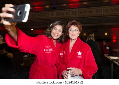 New York, NY - February 8, 2018: Lilly Rocha and Marion Ross prepare backstage for Red Dress 2018 Collection Fashion Show at Hammerstein Ballroom