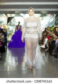 New York, NY - February 9, 2019: Model Ashley Graham walks runway for Christian Siriano New York fashion week Fall/Winter 2019 collection at Top of the Rock Rockefeller Center