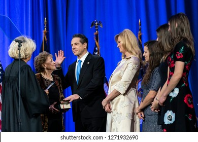 New York, NY - Jan 1, 2019: Governor Andrew Cuomo takes oath of office administered by Chief Judge of the New York Court of Appeals Janet DiFiore during inauguration for third term at Ellis Island