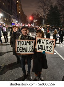 NEW YORK, NY - JAN 19: Two New Yorkers pose at an anti-Trump rally on Jan 19, 2017.  A large number of people took to the streets the day before Donald Trump's inauguration.