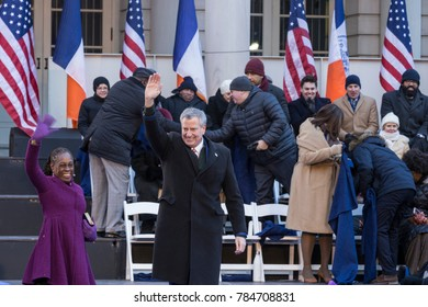 New York, NY - January 1, 2018: Mayor Bill de Blasio and wife Chirlane McCray wave to the crowd during inauguration for 2nd term in frigid weather in front of City Hall