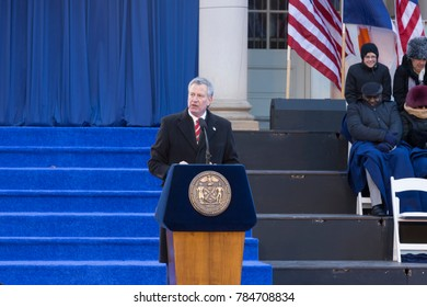 New York, NY - January 1, 2018: Mayor Bill de Blasio speaks during inauguration for 2nd term in frigid weather in front of City Hall