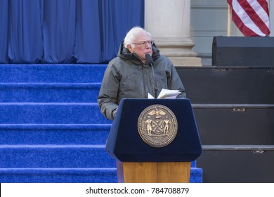 New York, NY - January 1, 2018: US Senator Bernie Sanders speaks during mayor, comptroller, public advocate inauguration for 2nd term in frigid weather in front of City Hall