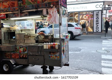 New York, NY - January 16, 2020: A New York hot dog stand on a street near Times Square in winter