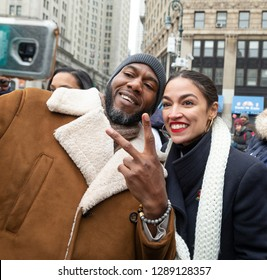 New York, NY - January 19, 2019: US Congresswoman Alexandria Ocasio-Cortez with supporter during Women's Unity Rally at Foley Square as hundreds of people attend