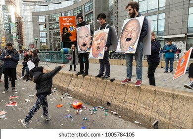 New York, NY - January 20, 2018: More than 120000 people participated in womens march in New York along streets of Manhattan. SVA students created art project Aim for Shithole with Tide Pods