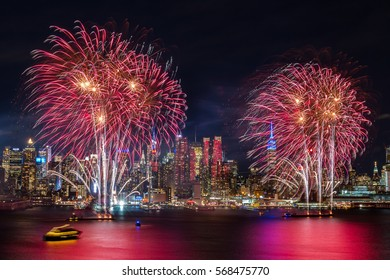 NEW YORK, NY - JANUARY 26, 2017: Spectacular fireworks over the Hudson River in front of the Midtown Manhattan skyline to celebrate Chinese New Year 2017 (Year of the Rooster) on January 29, 2017.