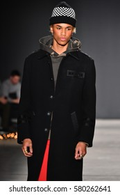 NEW YORK, NY - JANUARY 31: A model walks the runway during the Ovadia and Sons Runway show during NYFW: Mens at Skylight Clarkson North on January 31, 2017 in New York City.