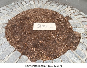 New York, NY - January 6, 2020: Shame sign on a ground while Harvey Weinstein arrives in court on 1st day of trial accused of rape and sexual misconduct at State Criminal Court