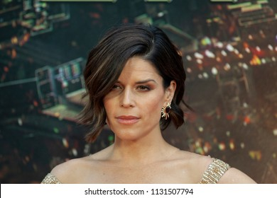 New York, NY - July 10, 2018: Neve Campbell wearing dress by Barney Cheng Couture attends the premiere of Skyscraper at AMC Loews Lincoln Center
