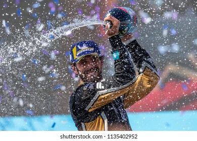 New York, NY - July 15, 2018:  Jean-Eric Vergne of Techeetah team celebrates with champagne winning Formula E car race round 12 & World Championship at NYC ePrix at Red Hook
