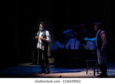 New York, NY - July 15, 2018: Steven Skybell as Tevye and Bruce Sabath as Leyzer-Wolf preform premiere of musical Fiddler on the Roof in Yiddish at Museum of Jewish Heritage