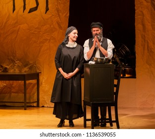 New York, NY - July 15, 2018: Steven Skybell as Tevye and Mary Illes as Golde perform during premiere of musical Fiddler on the Roof in Yiddish at Museum of Jewish Heritage
