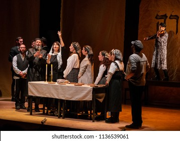 New York, NY - July 15, 2018: Sabbath Prayer scene during premiere of musical Fiddler on the Roof in Yiddish at Museum of Jewish Heritage